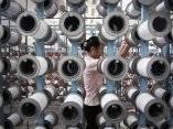 una-mujer-de-corea-del-norte-trabaja-en-la-fabrica-textil-kim-jong-suk-pyongyang-el-jueves-31-de-julio-de-2014-en-pyongyang-corea-del-norte-wong-maye-eap
