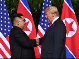 trump-kim-saludo-banderas