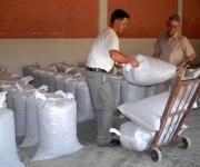 Trabajadores de la planta de beneficio del café en Jibacoa, laboran con la producción terminada del grano en el municipio de Manicaragua.