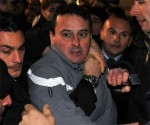 Massimo Tartaglia después de agredir a Silvio Berlusconi en mitin en Milán