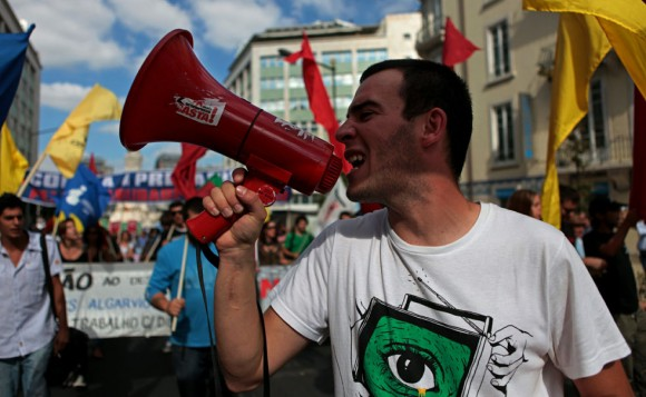 A Portuguese worker shouts as he takes part on a demo in downtown Lisbon on September 29, 2010. European trade unions called for 100,000 demonstrators to swarm the streets of Brussels next week to vent their anger at austerity measures imposed across the continent with demonstrations planned in several other countries including the Czech Republic, France, Ireland, Italy, Poland and Romania.