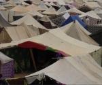 Miles de saharauis, en un campamento improvisado a 13 kilómetros al este de El Aaiún para protestar contra Marruecos.-