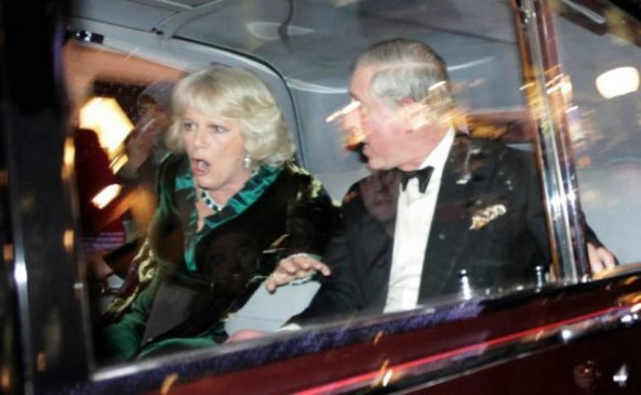 "ALTERNATIVE CROP TO LMD120 Britain's Prince Charles and Camilla, Duchess of Cornwall react as their car is attacked, in London, Thursday, Dec. 9, 2010. Angry protesters in London have attacked a car containing Prince Charles, the heir to the British throne, and his wife Camilla, Duchess of Cornwall. An Associated Press photographer saw demonstrators kick the car in Regent Street, in the heart of London's shopping district. The car then sped off. Charles' office, Clarence House, confirmed that ""their royal highnesses' car was attacked by protesters on the way to their engagement at the London Palladium this evening, but their royal highnesses are unharmed."" (Matt Dunham / AP)"