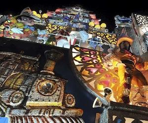 """HAB12. MAYABEQUE (CUBA) 02/01/11.- Detalle de la carroza perteneciente al bando Ceiba de Plata que participa, hoy domingo 02 de enero, en la fiesta conocida como """"las Charangas de Bejucal"""", una mezcla de carnaval, baile y espect·culo de magia que se considera como una de las tradiciones populares m·s antiguas de la isla. La gran atracciÛn de la fiesta consiste en presenciar las """"sorpresas"""" que van revelando las carrozas de cada bando, ubicadas en extremos opuestos de la plaza, donde el p˙blico asiste a la transformaciÛn de un cajÛn rodante en un edificio de luces y color de casi 20 metros. EFE/Alejandro Ernesto"""