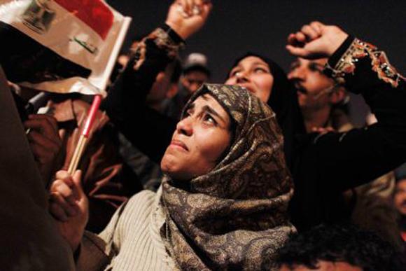 Una mujer llora de alegría. Foto: AP