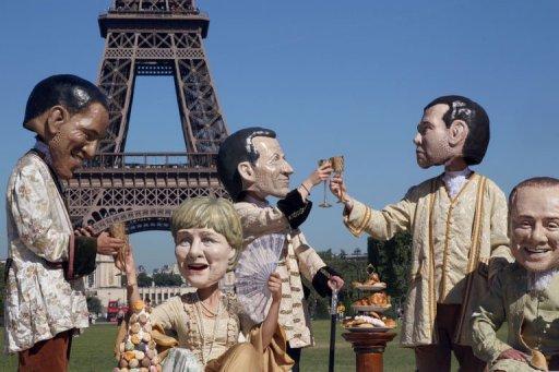 Activistas de Oxfam interpretan a los líderes del G-8. Foto: AFP, Pierre Verdy)