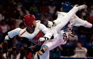 EL cubano Frank Ismael Diaz, (rojo), obtiene la primera medalla (bronce) de la delegacion cubana en el Taekwondo. Foto: Ismael Francisco