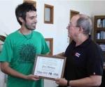 Silvio Rodríguez y el presidente de la FUBA, Ignacio Kostzer