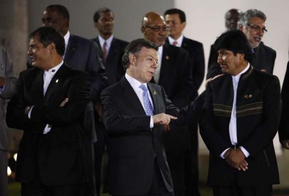 Correa, Santos y Evo