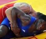ucha Greco Romana 96 kg Yunior Batista gana y va a discutir bronce.