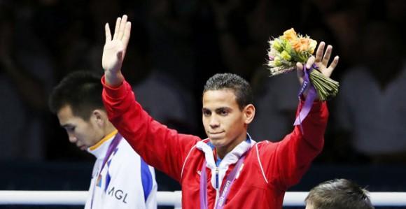El cubano Robeisy Ramirez Carrazana se alzó con la medalla de oro al imponerse al mongol Tugstsogt Nyambayar en la prueba masculina de boxeo peso mosca (52kg) de los Juegos Olímpicos de Londres.  Foto: AFP