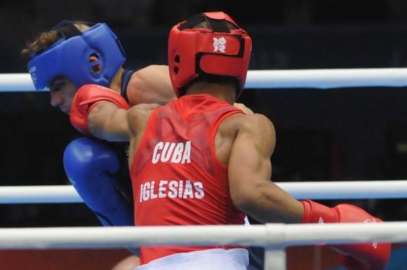 Roniel Iglesias se impuso al ucraniano Denys Berinchyk, quien le había derrotado en el Mundial de Bakú-2011, pero esta vez no pudo ganar ni un solo asalto y cayó 15 golpes por 22.  Foto: Ricardo López Hevia