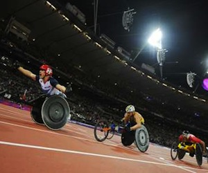 Great Britain's David Weir (L) reacts as he crosses the finish line to win the Men's 5000 metres T54 Final during the London 2012 Paralympic Games at the Olympic Park in east London, on September 2, 2012.  AFP PHOTO / GLYN KIRK