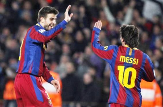 Piqué y Messi.