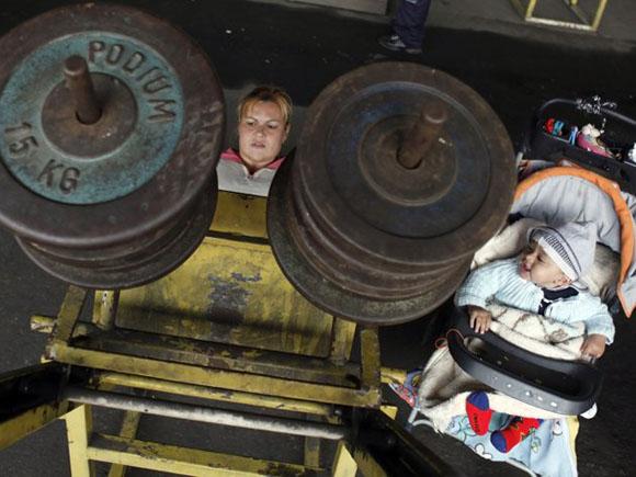 Los sacrificios de una madre-atleta. Fotos: REUTERS/Nacho Doce.