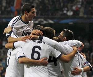 Real Madrid's Angel di Maria jumps over mates to celebrate mate Cristiano Ronaldo goal against Galatasaray