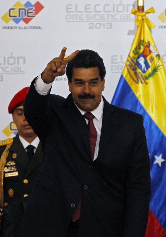 Venezuela's President-elect Nicolas Maduro gestures as he arrives at the CNE to receive his confirmation as winner of Sunday's election in Caracas