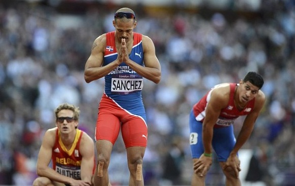 Dominican Republic's Felix Sanchez gestures after finishing first in the men's 400m hurdles semi-finals at the London 2012 Olympic Games at the Olympic Stadium