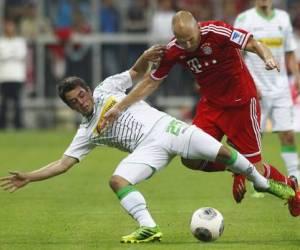 El holandés Arjen Robben, del Bayern Munich (derecha), abrió el marcador al minuto 12. Foto Reuters