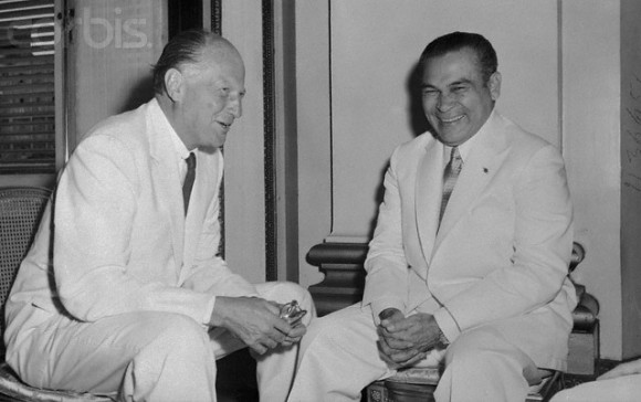 July 1957, Havana, Cuba --- Cuban President Fulgencio Batista, (R), enjoys a chat with the new United States Ambassador to Cuba, Earl E. T. Smith, after the latter presented his credentials here on July 23rd. --- Image by © Bettmann/CORBIS