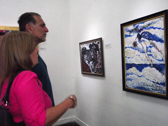 """Dentro de  los asistentes a la inauguración de la exposición """"Amor de Ciudad"""" estuvieron René  González Sehweret, Héroe de la República de Cuba y su esposa Olga Salanueva Arango. Foto: Marianela Dufflar."""