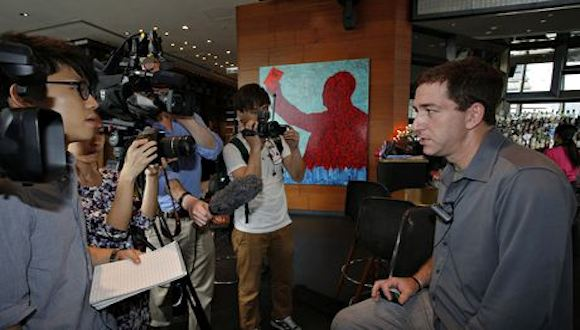 Greenwald talking to reporters on 10 June 2013, the day after Snowden revealed his identity in the G