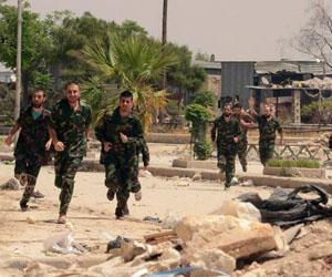 Soldados del Ejército sirio celebran su liberación por los rebeldes. Foto: Jorge Ourfalian/Reuters.