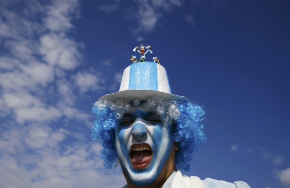 An Argentina soccer fan cheers outside the World Cup 2014 soccer stadium prior to the Group F match between Argentina and Iran in Belo Horizonte