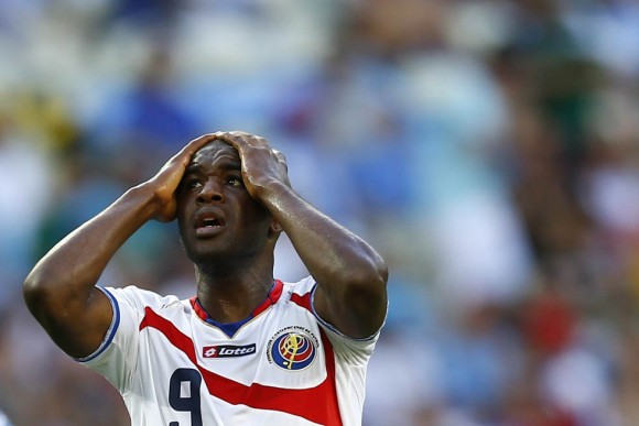 Costa Rica's Campbell reacts after missing a chance to score a goal during their 2014 World Cup Group Dsoccer match against Uruguay at the Castelao stadium in Fortaleza