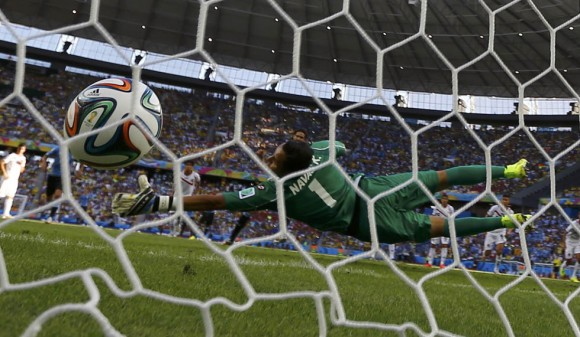 Costa Rica's Keilor Navas fails to save a penalty goal shot by Uruguay's Cavani during World Cup soccer match in Fortaleza