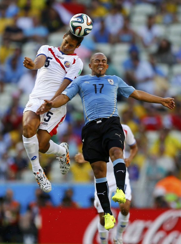 Costa Rica's Borges and Uruguay's Rios fight for the ball during their 2014 World Cup Group D soccer match at the Castelao stadium in Fortaleza