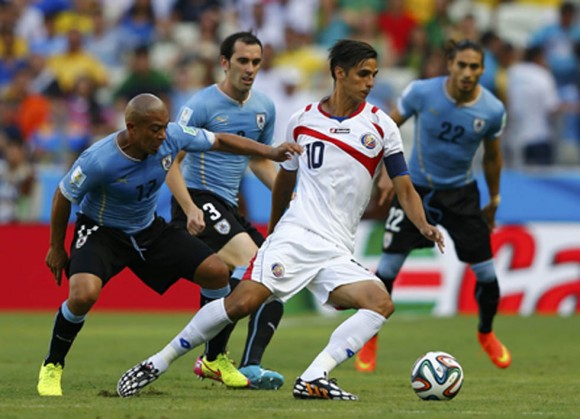 Uruguay's Egidio Arevalo Rios and Costa Rica's Ruiz fight for the ball during World Cup soccer match in Fortaleza