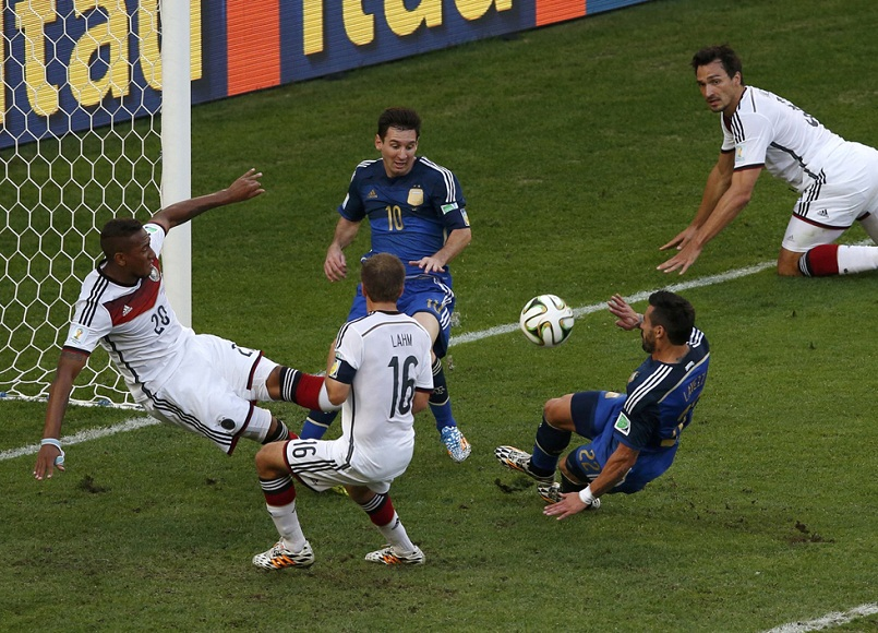 Germany's Boateng makes a save during their 2014 World Cup final against Argentina at the Maracana stadium in Rio de Janeiro