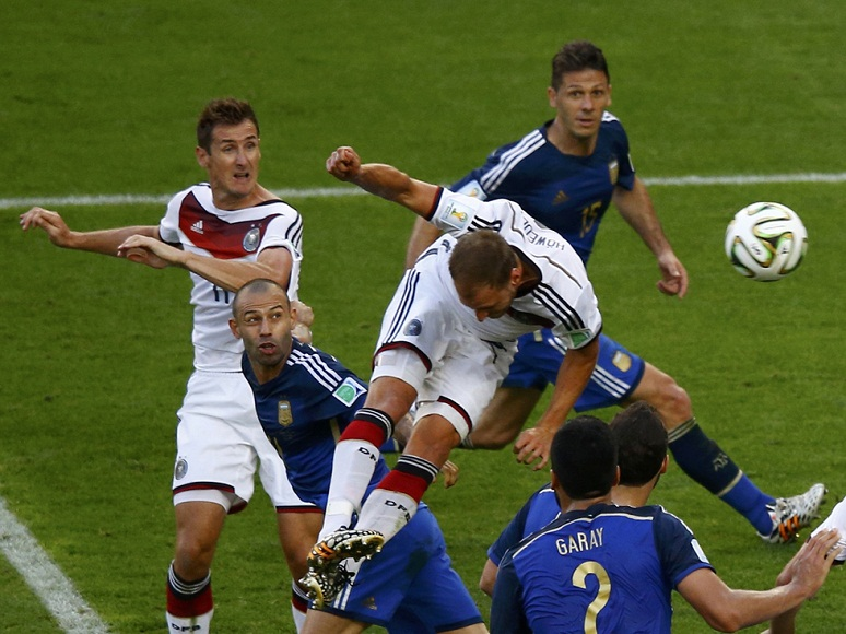 Germany's Benedikt Hoewedes misses a chance to score during their 2014 World Cup final against Argentina at the Maracana stadium in Rio de Janeiro