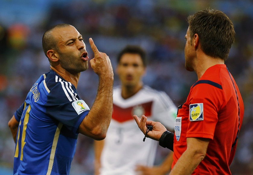 Argentina's Mascherano reacts near referee Rizzoli during their 2014 World Cup final at the Maracana stadium in Rio de Janeiro