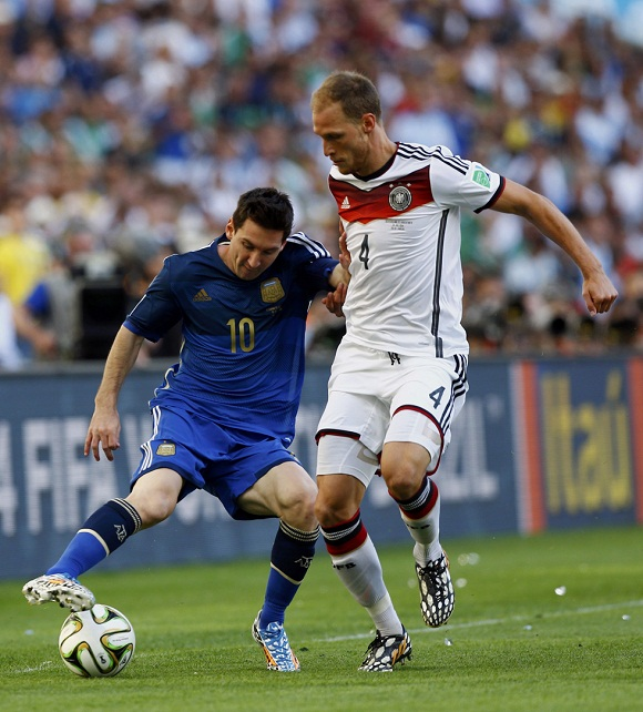 Argentina's Messi fights for the ball with Germany's Hoewedes during their 2014 World Cup final at the Maracana stadium in Rio de Janeiro