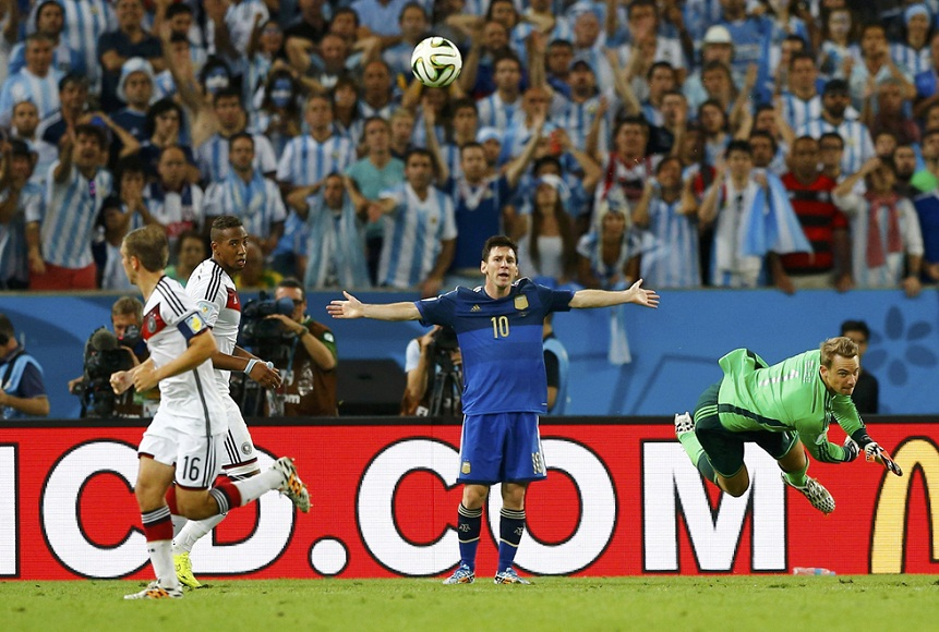 Germany's goalkeeper Manuel Neuer hits the ball out, as Argentina's Lionel Messi reacts, during their 2014 World Cup final at the Maracana stadium