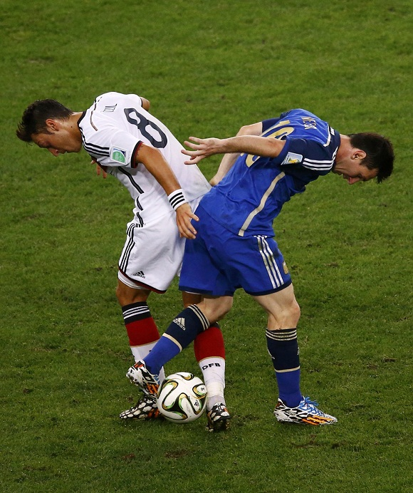 Argentina's Lionel Messi and Germany's Mesut Ozil fight for the ball during their 2014 World Cup final at the Maracana stadium in Rio de Janeiro