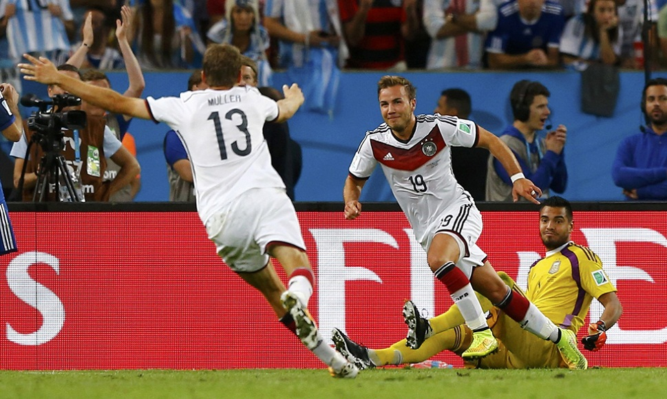 Germany's Mario Goetze celebrates with Thomas Mueller after scoring a goal during the 2014 World Cup final between Germany and Argentina at the Maracana stadium