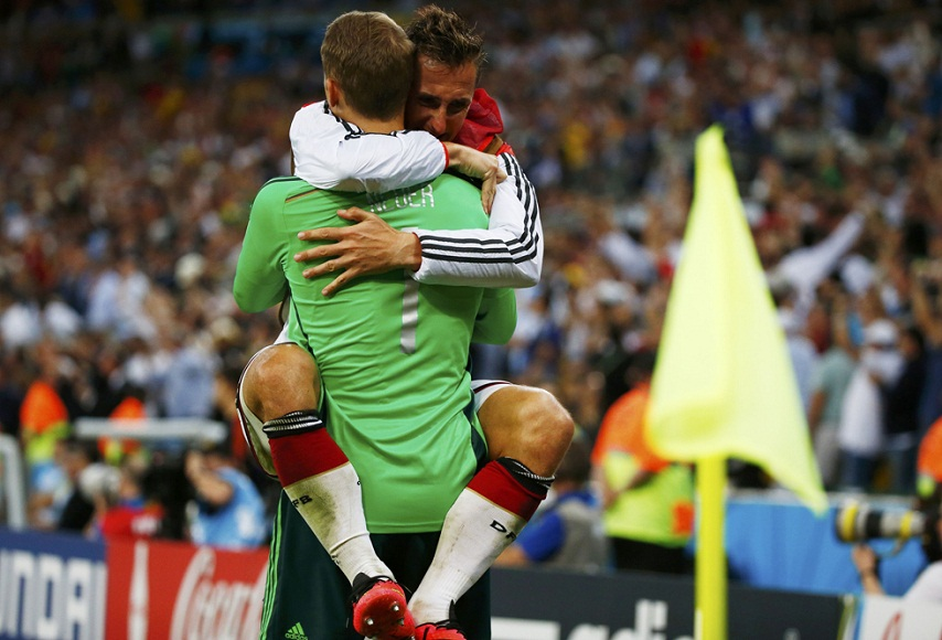 Germany's Klose hugs Neuer after Goetze scored against Argentina during extra time in their 2014 World Cup final at the Maracana stadium in Rio de Janeiro