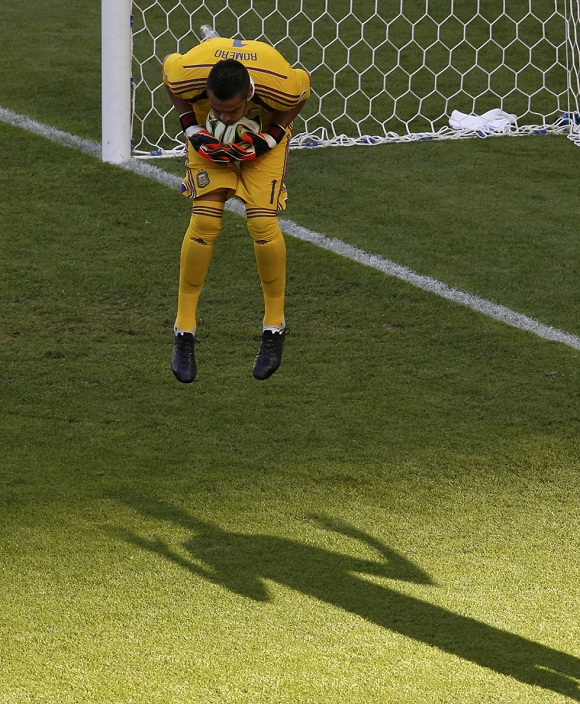 Argentina's goalkeeper Romero makes a save during their 2014 World Cup final against Argentina at the Maracana stadium in Rio de Janeiro