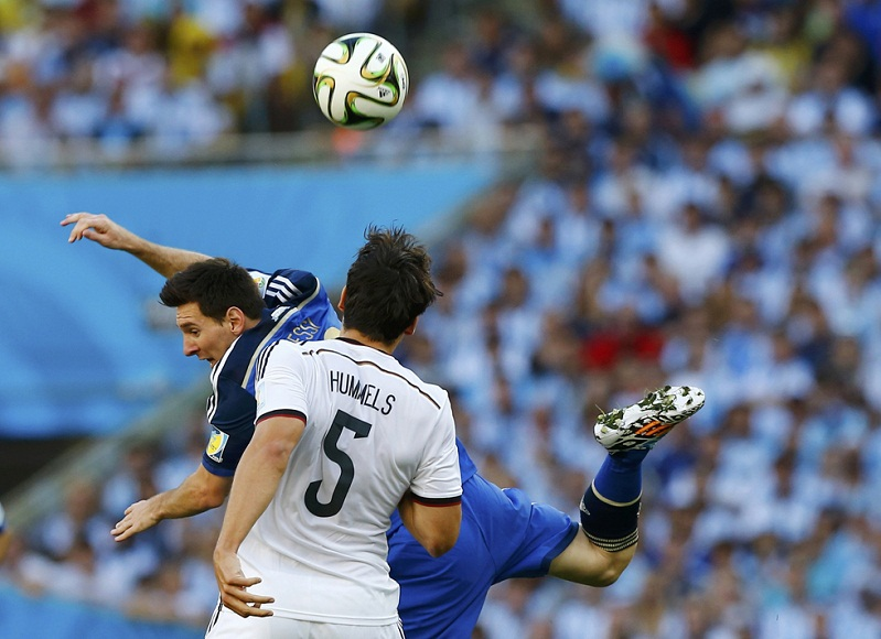 Argentina's Messi fights for the ball with Germany's Hummels during their 2014 World Cup final at the Maracana stadium in Rio de Janeiro