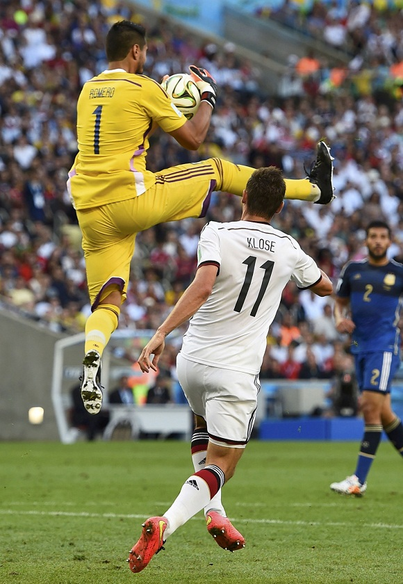 Argentina's goalkeeper Romero jumps to save the ball near Germany's Klose during their 2014 World Cup final in Rio de Janeiro