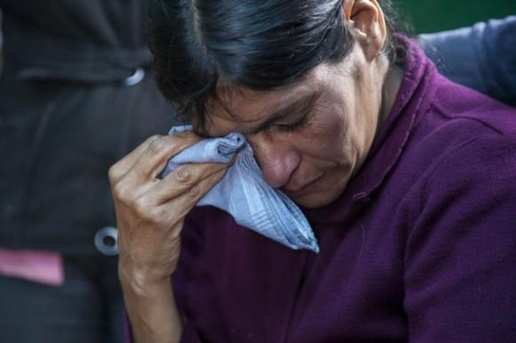 La guatemalteca Cipriana Juárez, enferma y en cama, señaló que su hijo Gilberto le dijo que quería ganar dinero para ayudarla. Foto: LUIS SOTO / AP.