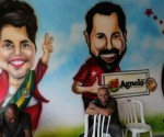 En la sede del comité electoral del PT luce este mural con caricaturas de la presidenta Dilma Rousseff el gobernador de Brasilia Agnelo Queiros y el ex mandatario Luiz Inacio Lula da Silva
