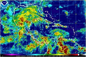 Imagen de satélite del espectro Infrarrojo con seudo-color. Se observa la Depresión Tropical No. 9 en el golfo de Campeche, aproximándose a la península de Yucatán, así como el flujo de aire húmedo que, procedente del sudeste, llega con lluvias al occidente y centro de Cuba. Estas áreas de lluvia pueden incrementarse más durante los próximos dos o tres días.