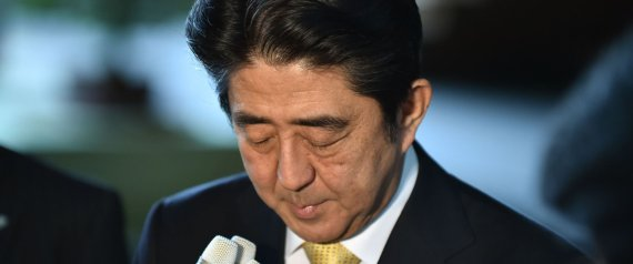 Japanese Prime Minister Shinzo Abe bows his head during a short press interview at the latter's official residence in Tokyo on October 20, 2014. Two of the five women in Shinzo Abe's Japanese cabinet resigned, beset by allegations of misusing political funds, dealing a blow to the prime minister's efforts to boost the profile of women. AFP PHOTO / KAZUHIRO NOGI
