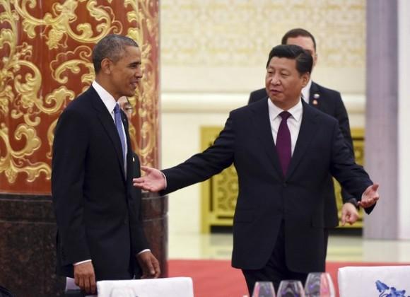 Los presidentes Barack Obama, de Estados Unidos, y Xi Jinping, de China, en una reunión en Pekín, este miércoles. Foto: Ap.