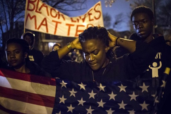 Protesters, demanding the criminal indictment of a white police officer who shot dead an unarmed black teenager in August, march through a suburb in St. Louis, Missouri November 23, 2014.