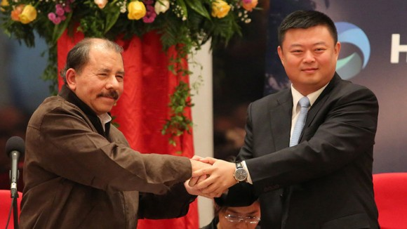 Nicaraguan President Daniel Ortega and Chinese tycoon Wang Jing on Saturday said plans to start building a $40-billion canal across the Central American country were on track for late 2014. Wang Jing's Beijing Interoceanic Canal Investment Management Co. has secured the right to dig a waterway in Nicaragua that will rival the Panama Canal and be hugely significant to world trade if it is completed. AFP PHOTO/ Inti OCON